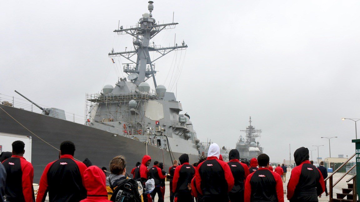 Louisville players approach the USS Farragut navy destroyer (WDRB photo by Eric Crawford)
