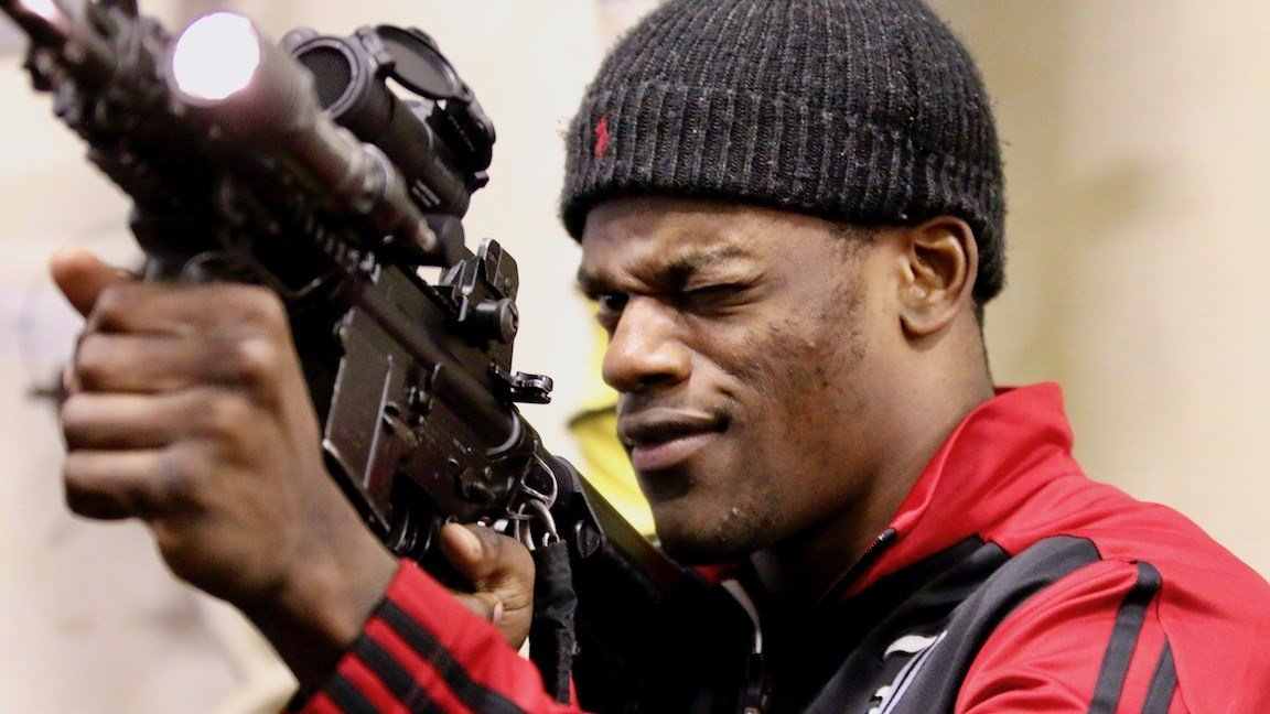 Lamar Jackson, locked and loaded, during a tour of the USS Farragut on Thursday (WDRB photo by Eric Crawford)