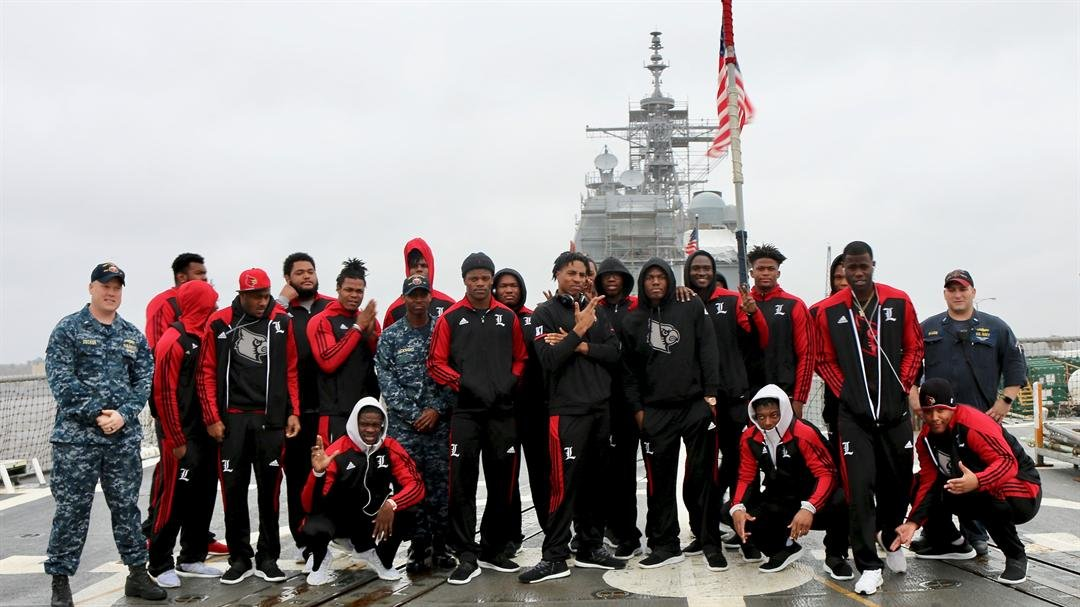 Louisville players on the deck of the USS Farragut on Thursday (WDRB photo by Eric Crawford)