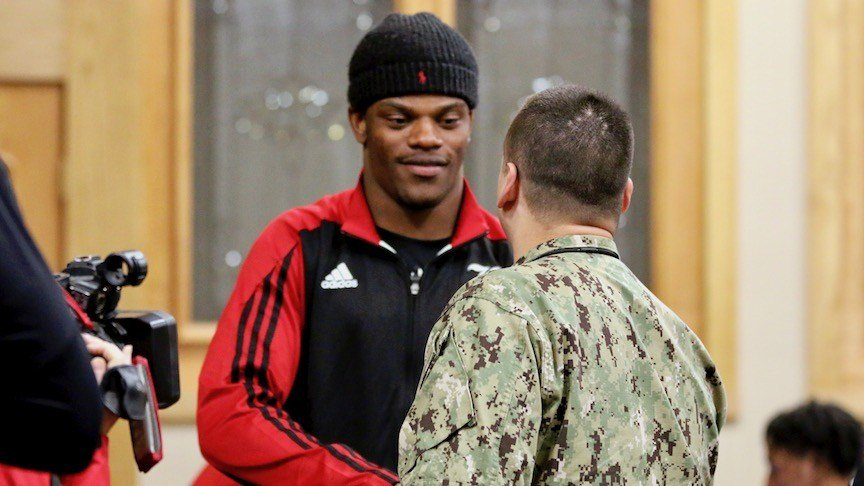 Louisville quarterback Lamar Jackson meets Navy logistics specialist first class Jaymes Waite of Independence, Ky. (WDRB photo by Eric Crawford)
