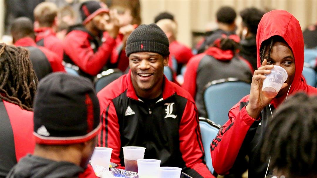 Lamar Jackson with teammates in Jacksonville this week. (WDRB photo by Eric Crawford)