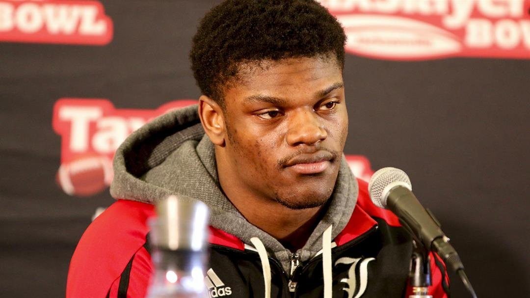 Lamar Jackson listens to a question at a news conference on Friday in Jacksonville. (WDRB photo by Eric Crawford)