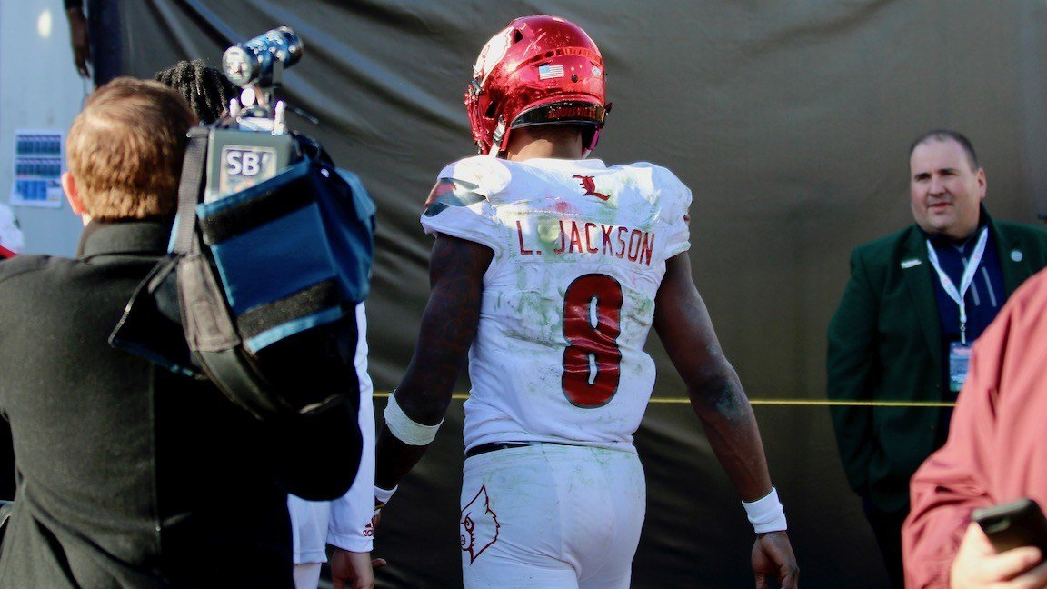 Lamar Jackson walks off the field after Louisville's loss to Mississippi State in the TaxSlayer Bowl (WDRB photo by Eric Crawford)