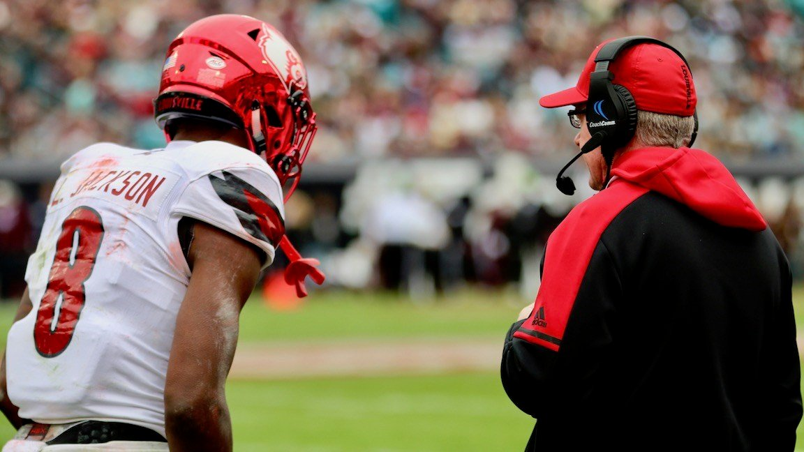 Jackson and Petrino confer in the first half (WDRB photo by Eric Crawford)