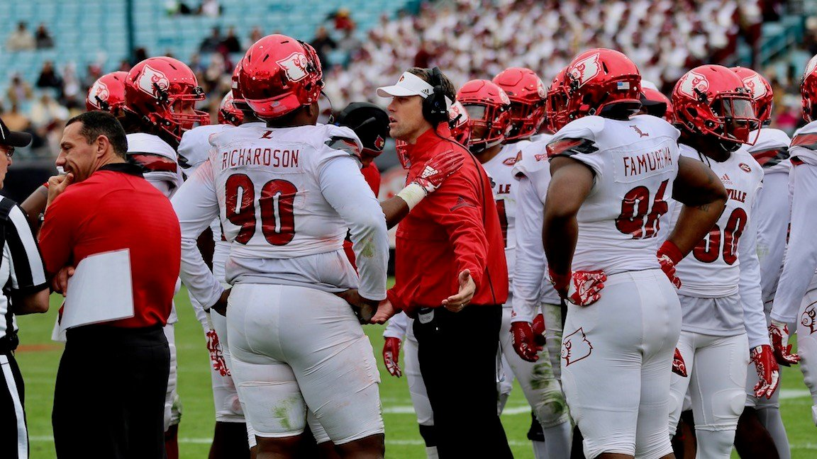 Defensive coordinator Peter Sirmon makes a point to his players after some early struggles. (WDRB photo by Eric Crawford)