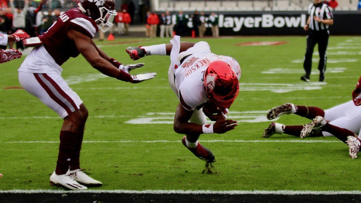 Jackson twists and lunges for a first-half touchdown (WDRB photo by Eric Crawford)