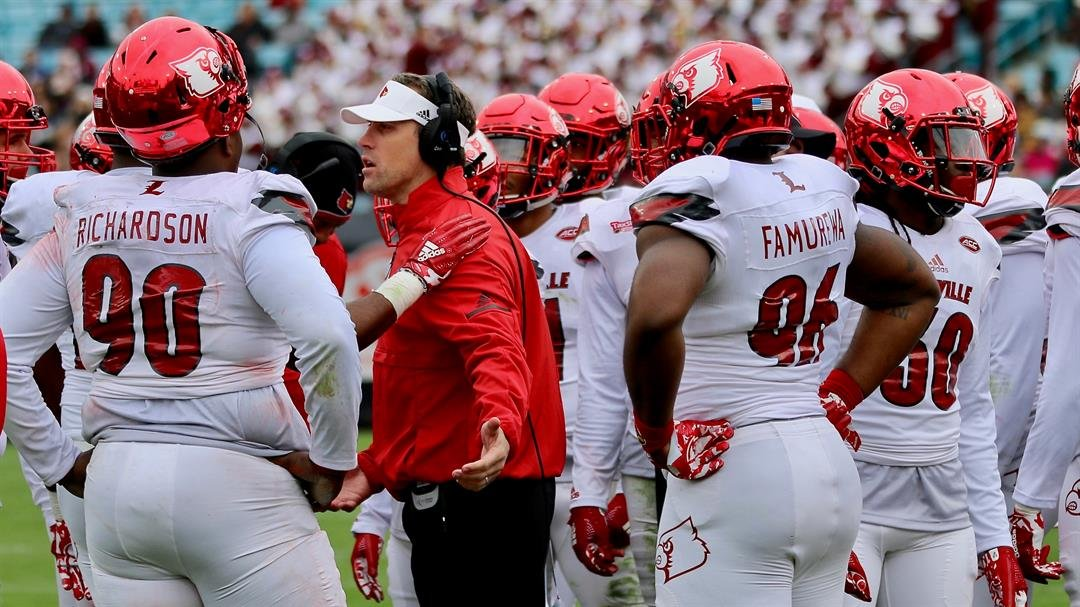 Louisville defensive coordinator Peter Sirmon talks with his unit after giving up back-to-back scoring drives to open the TaxSlayer Bowl (WDRB photo by Eric Crawford)