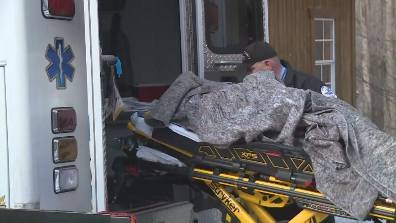Woman loaded into ambulance after freezing night in the forest in Berea, Ky. Jan. 1, 2018