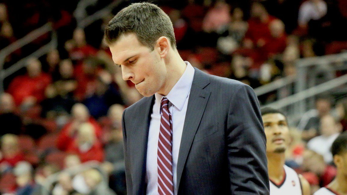 David Padgett ponders his options before speaking to his team during a timeout (WDRB photo by Eric Crawford)