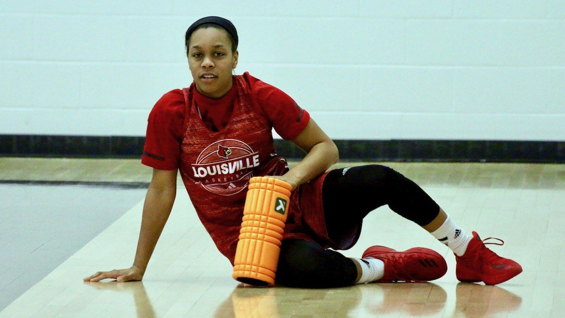 Asia Durr takes a break from stretching before practice. (WDRB photo by Eric Crawford)