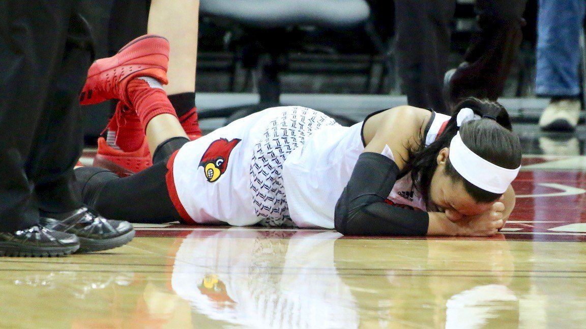 Asia Durr fell to the court with a sprained ankle in the second quarter of Thursday's win over Duke (WDRB photo by Eric Crawford)