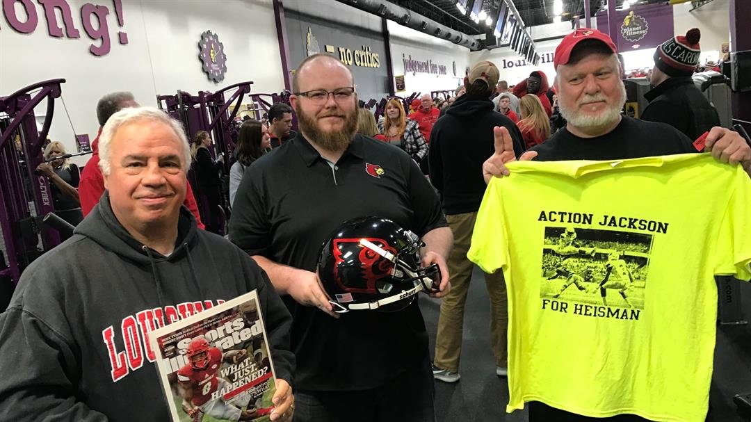 Steven Simon (from left), Ryan Ray and Ed Cecil were the first three fans in line for Lamar Jackson's autograph at Planet Fitness Saturday.