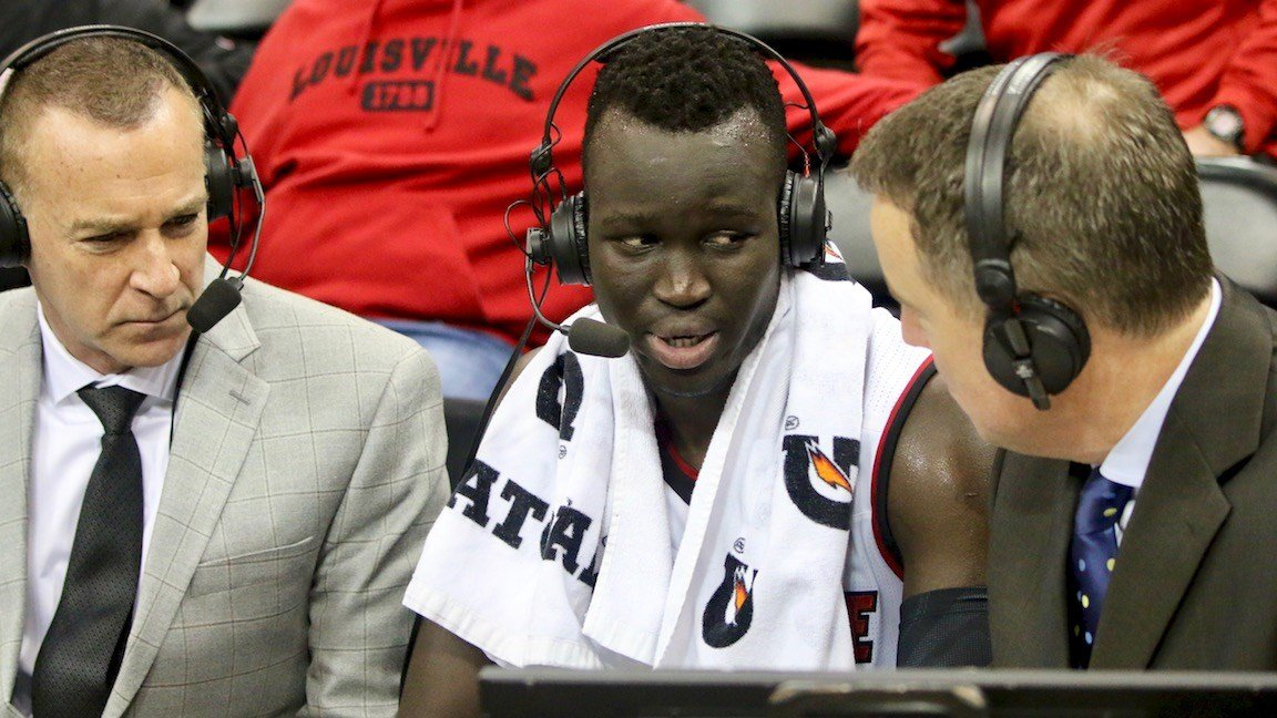 Deng Adel speaks with ESPN announcers after his career-high performance (WDRB photo by Eric Crawford)