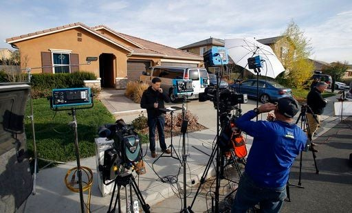 (AP Photo/Alex Gallardo). Members of the media work outside a home Tuesday, Jan. 16, 2018, where police arrested a couple on Sunday accused of holding 13 children captive, in Perris, Calif.