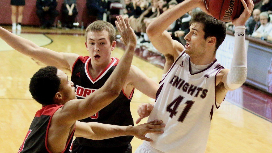 Bellarmine's Adam Eberhard fights off a Drury double-team to dish out one of his game-high 10 assists. (WDRB photo by Eric Crawford)