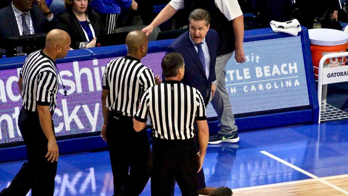 John Calipari makes a point to game officials at halftime. (WDRB photo by Eric Crawford)