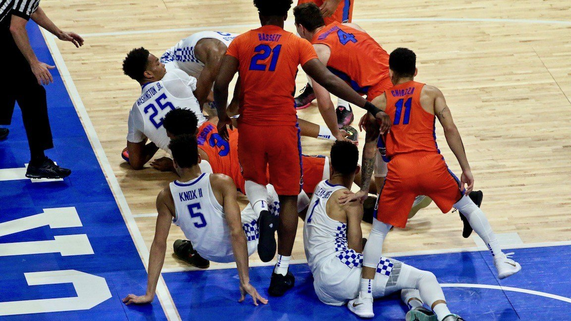 Kentucky and Florida scramble for a loose ball early in the game. (WDRB photo by Eric Crawford)