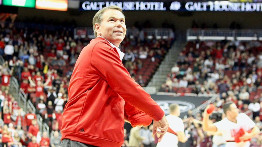 Vince Tyra throws T-shirts to fans during a timeout of a women's basketball game in December. (WDRB photo by Eric Crawford)