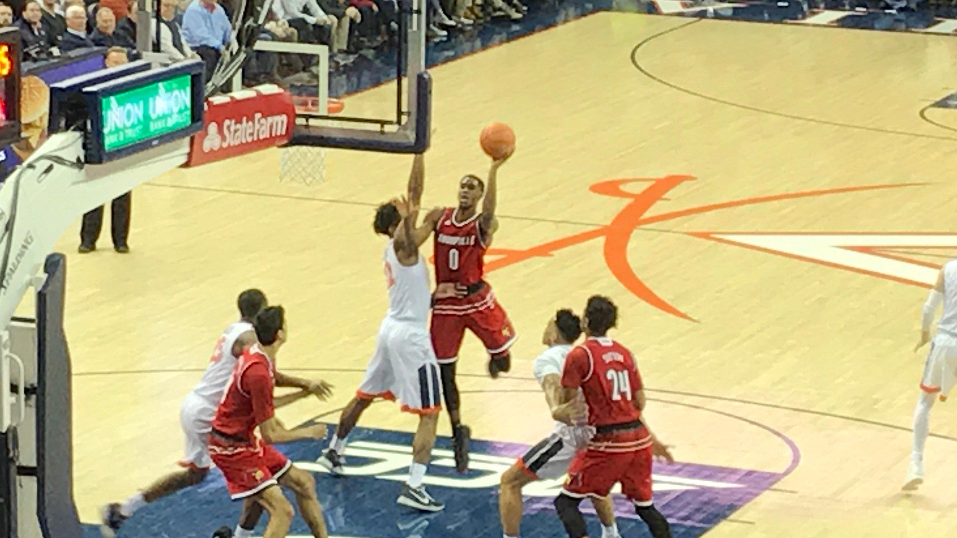 V.J. King scored in traffic for Louisville against Virginia Wednesday night.