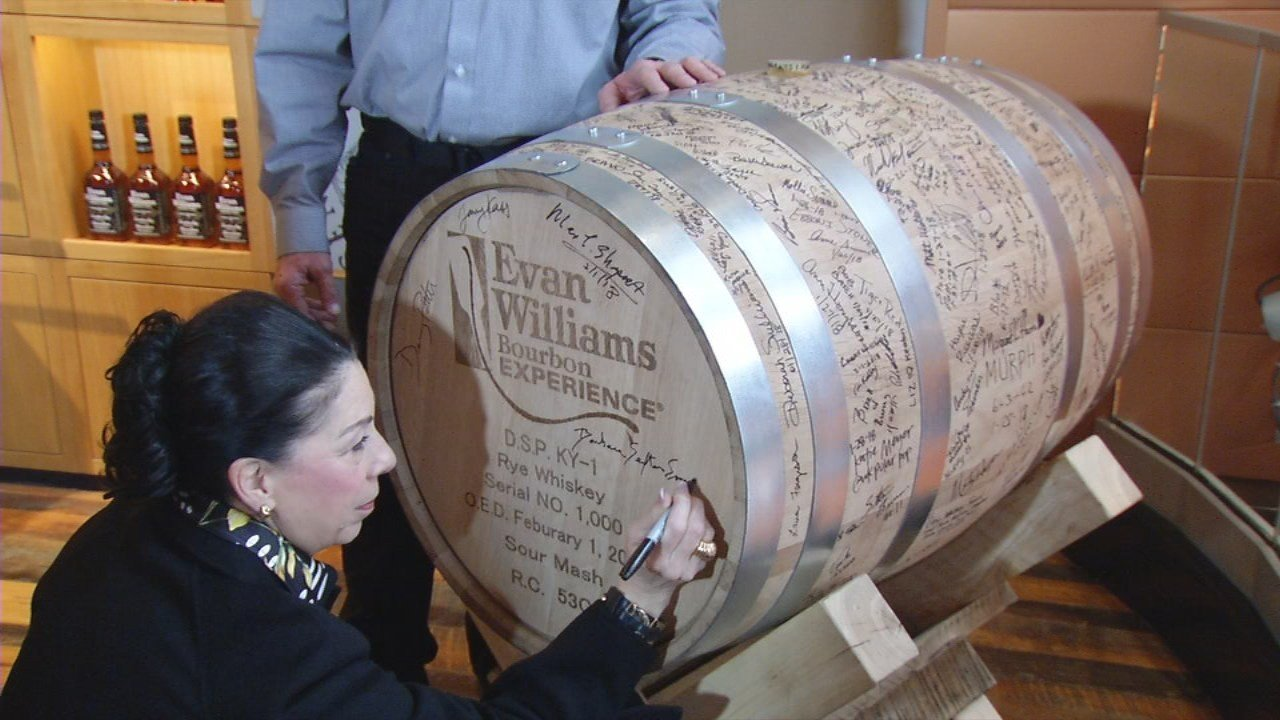 Dignitaries sign the top of the 1,000th barrel of bourbon distilled at the Evan Williams Experience.  Feb. 1, 2018