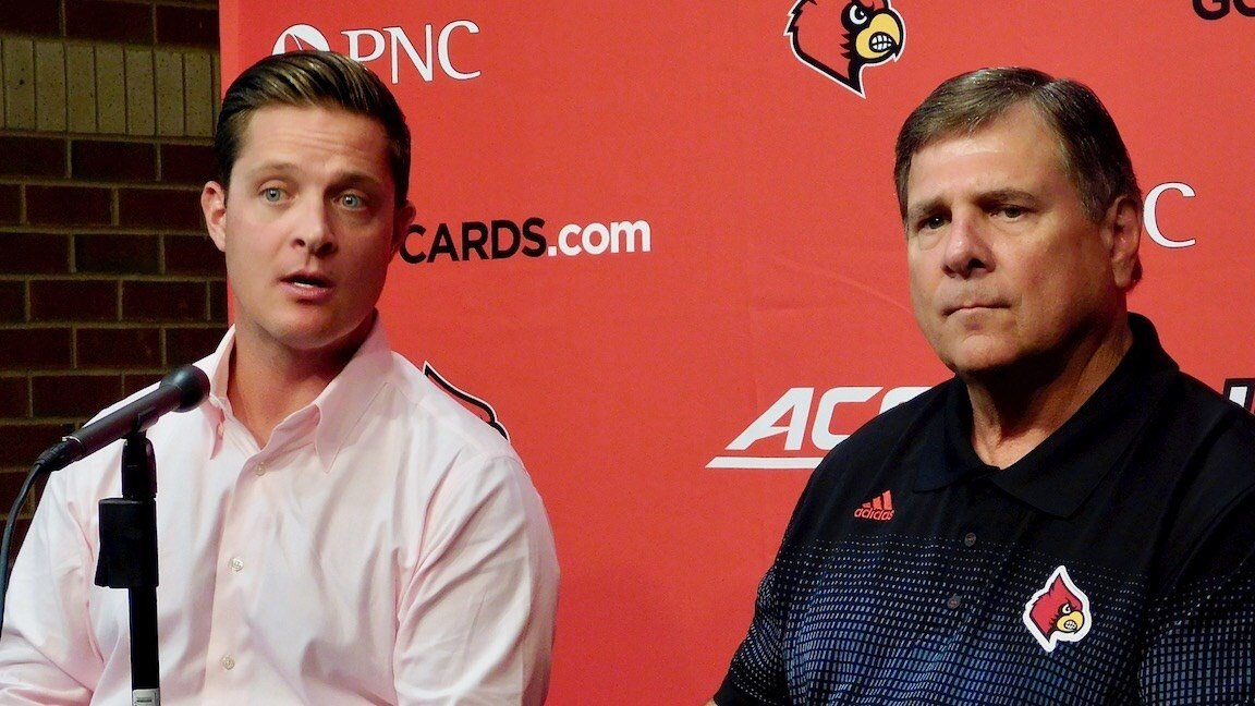 Mark Jurich, left, and his father Tom Jurich