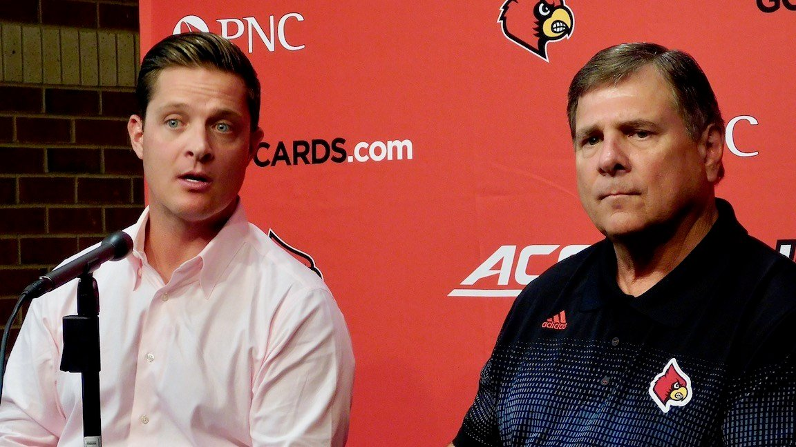 Mark and Tom Jurich discussion Papa John's Stadium expansion in a 2015 news conference. (WDRB photo by Eric Crawford)