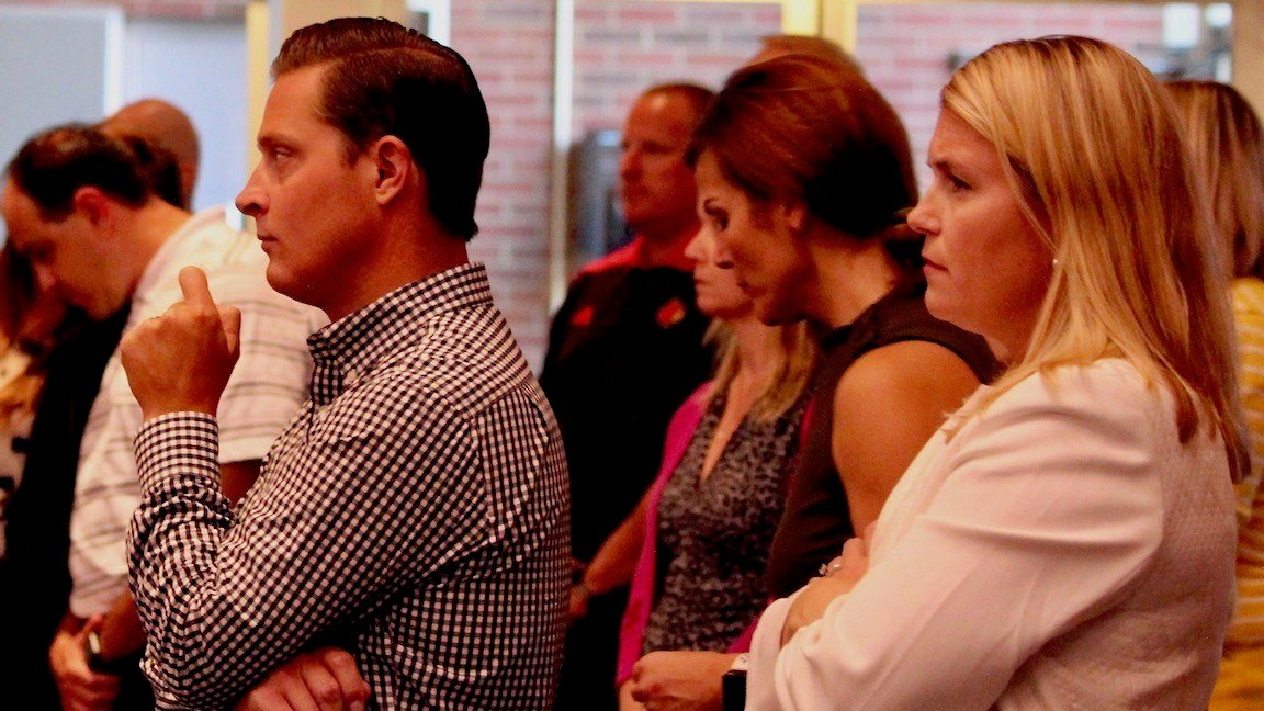 Julianne Waldron, far right, and Mark Jurich, watch as Vince Tyra is introduced as interim athletic director last October. Both were let go by the university on Friday. (WDRB photo by Eric Crawford)
