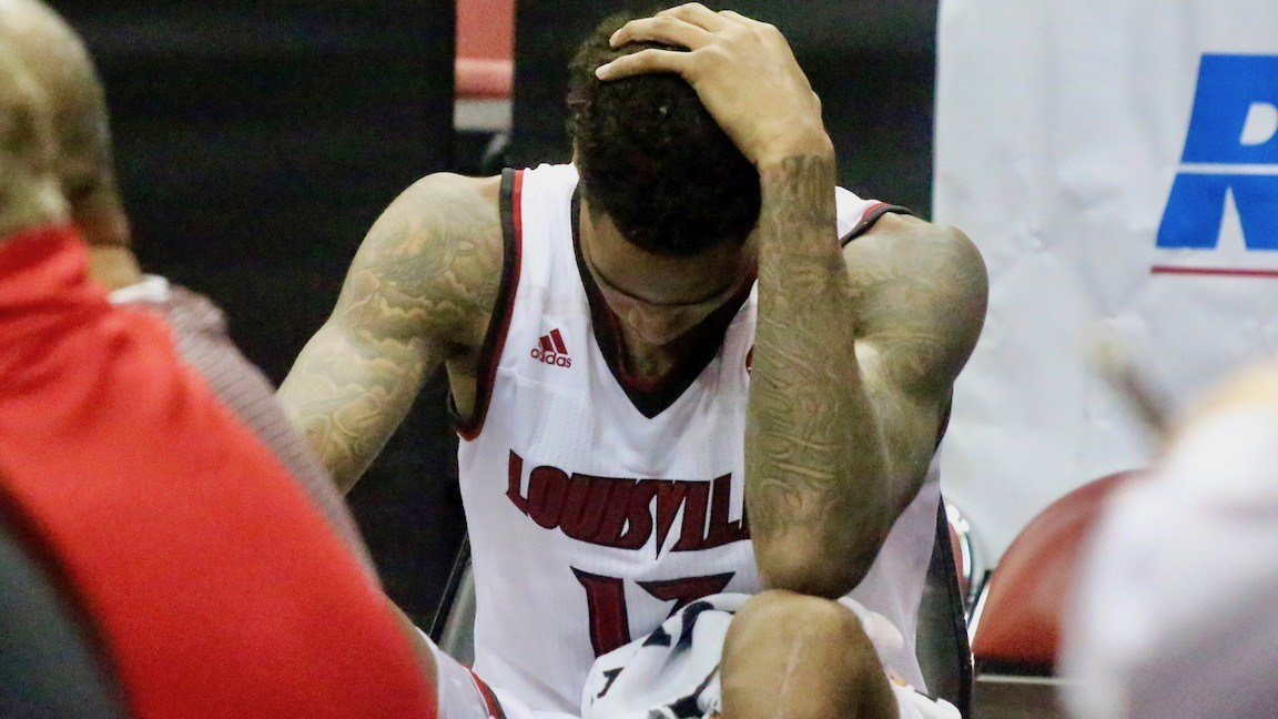 Ray Spalding can't bear to watch as he spends the final four minutes of Saturday's loss on the bench with a sprained ankle. (WDRB photo by Eric Crawford)