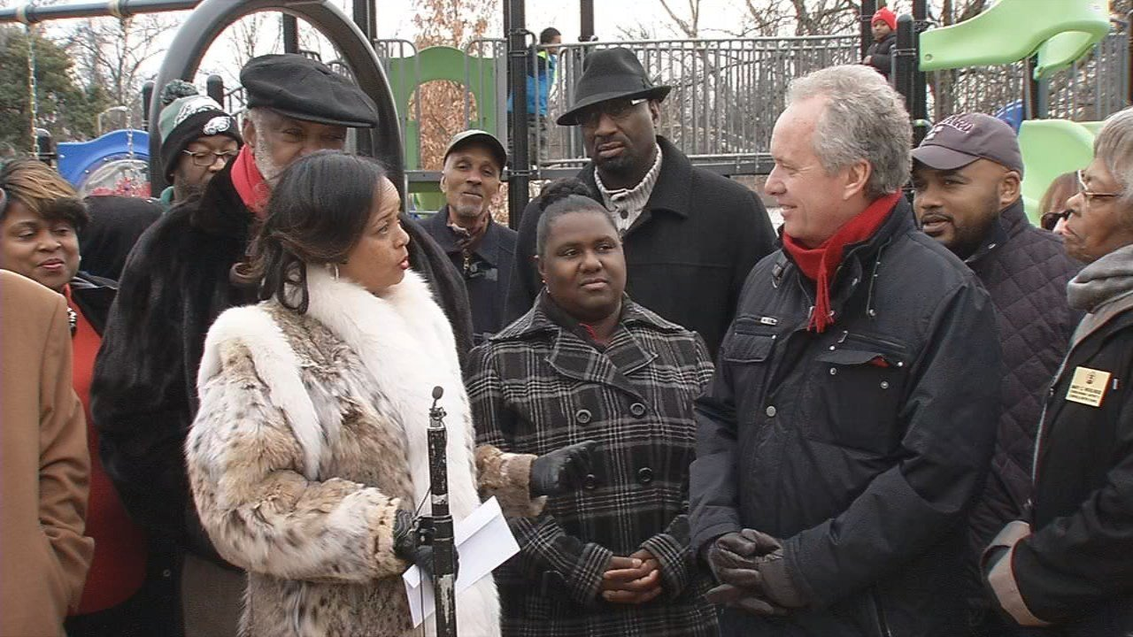 Mayor Greg Fischer was presented with a $4,000 check from former U of L player and businessman Charlie Johnson and his wife LaDonna.