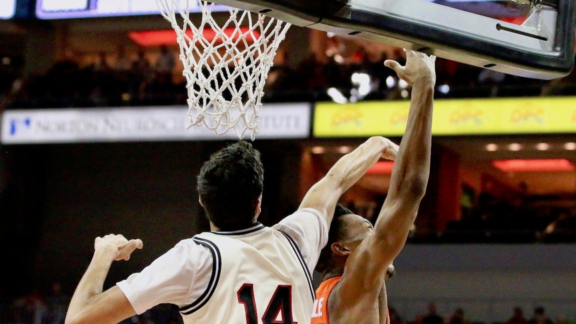 Anas Mahmoud commits a foul in the first half of Monday's loss to Syracuse. (WDRB photo by Eric Crawford)