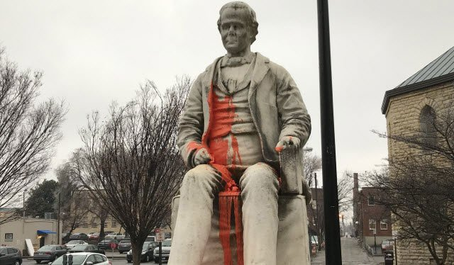 Someone poured an orange substance on a George Prentice statue outside the public library in downtown Louisville just before a meeting there to address public art.