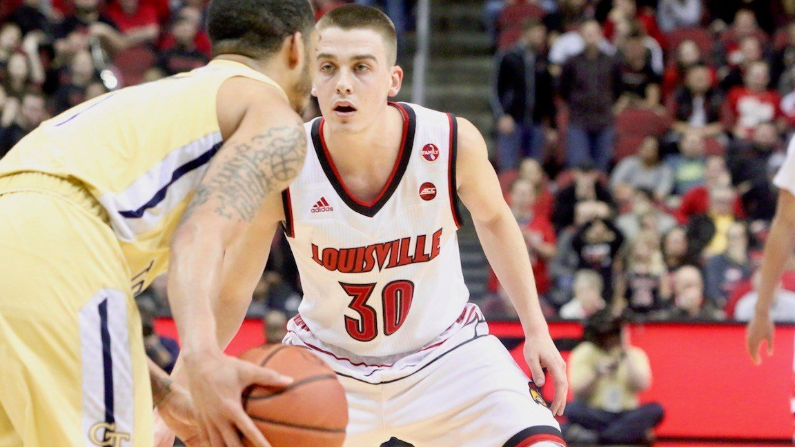 Louisville's defensive focus held Georgia Tech to 16 first-half points. Ryan McMahon applies pressure. (WDRB photo by Eric Crawford