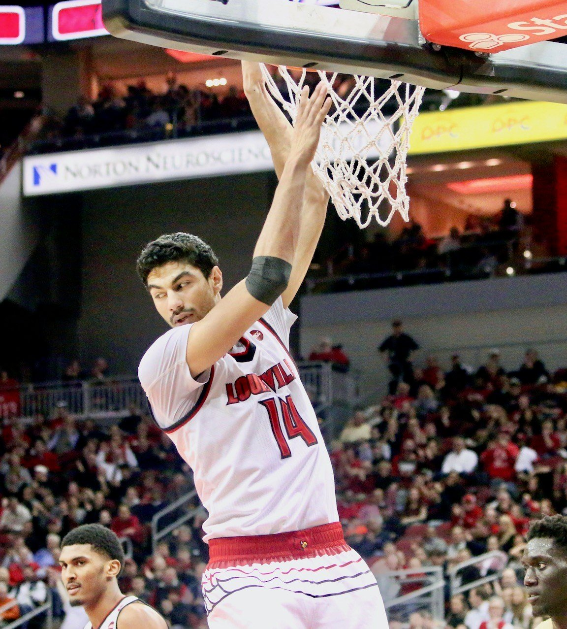 Anas Mahmoud finishes a second-half dunk for two of his 12 points. (WDRB photo by Eric Crawford)