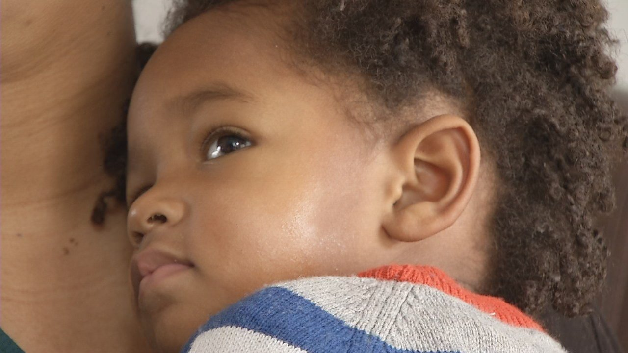 Two-year-old Charles Diggs, IV knows all about the aches and pains that the flu brings. He's already missed four days of daycare.