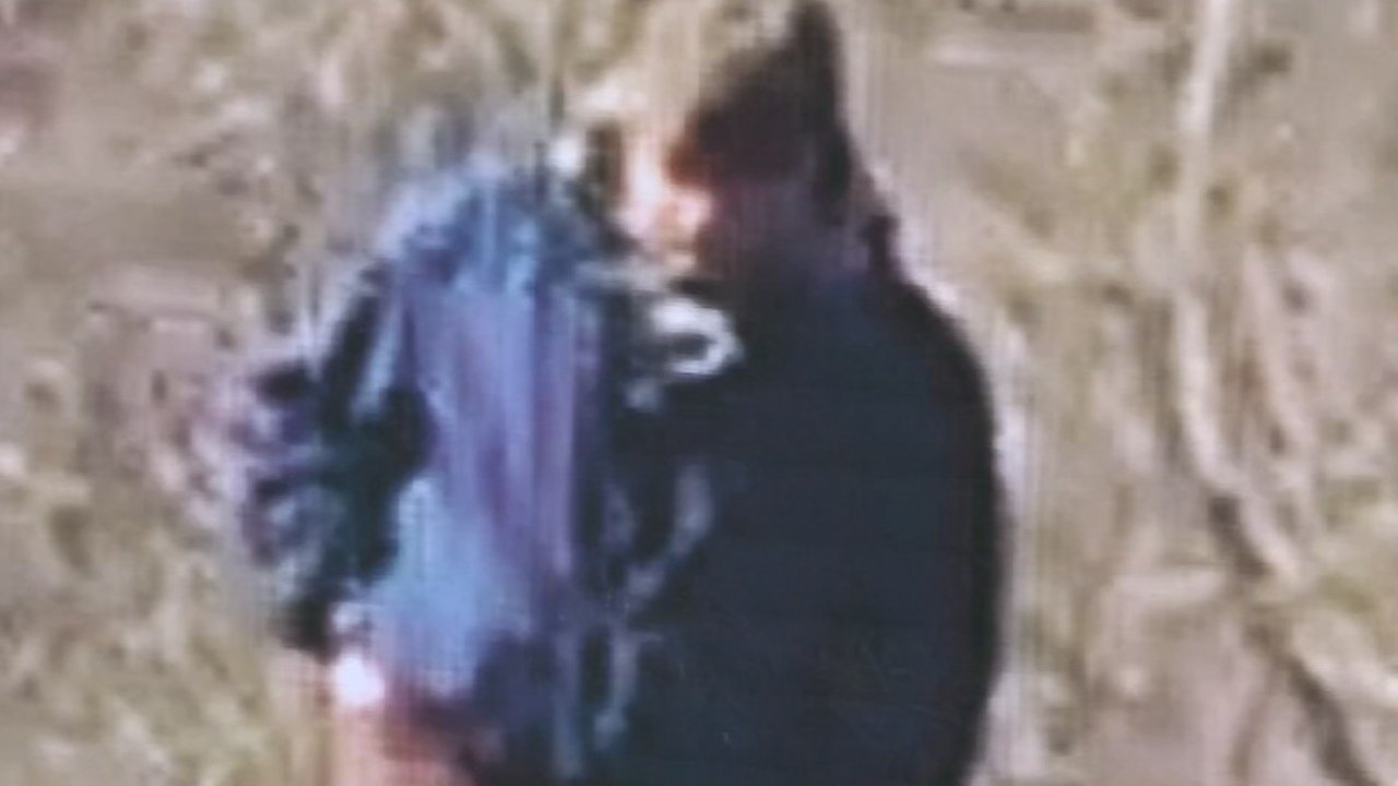 """Police released a grainy photo of the suspectand audio of him saying """"down the hill."""""""