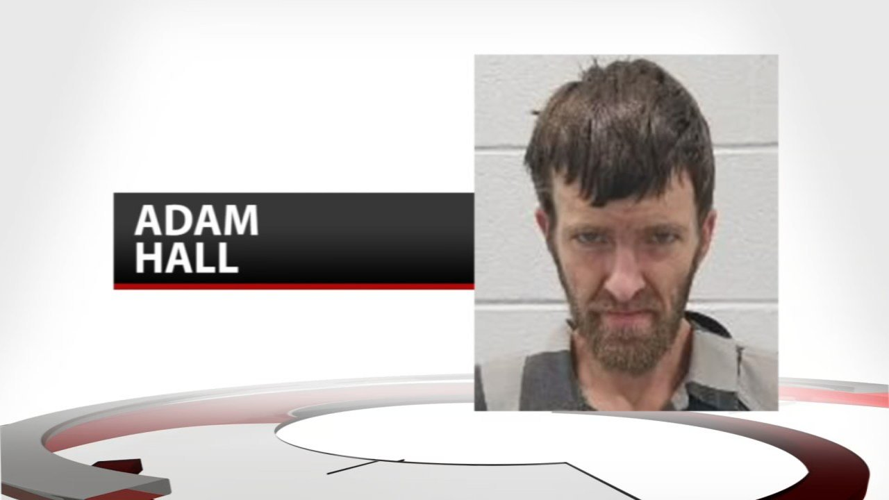 Police say Adam Hall was arrested with a fully automatic submachine gun, ammo and meth.
