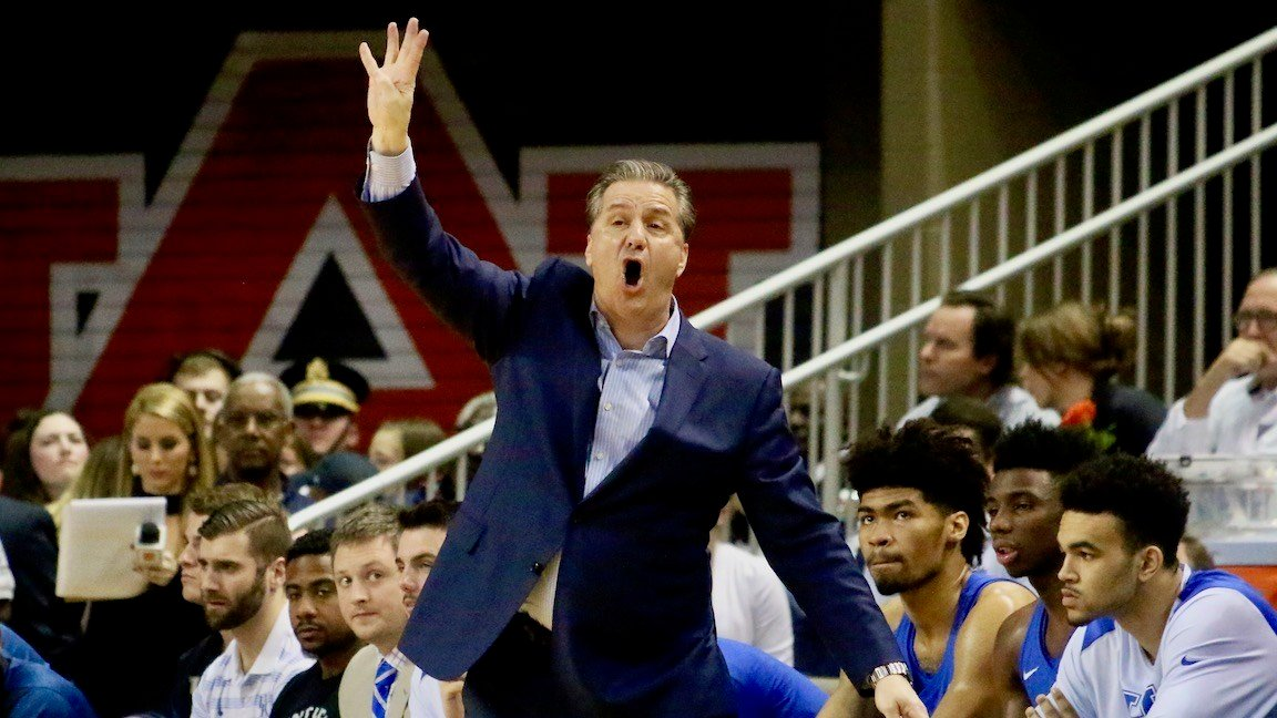 John Calipari motions to his team in the first half. (WDRB photo by Eric Crawford)