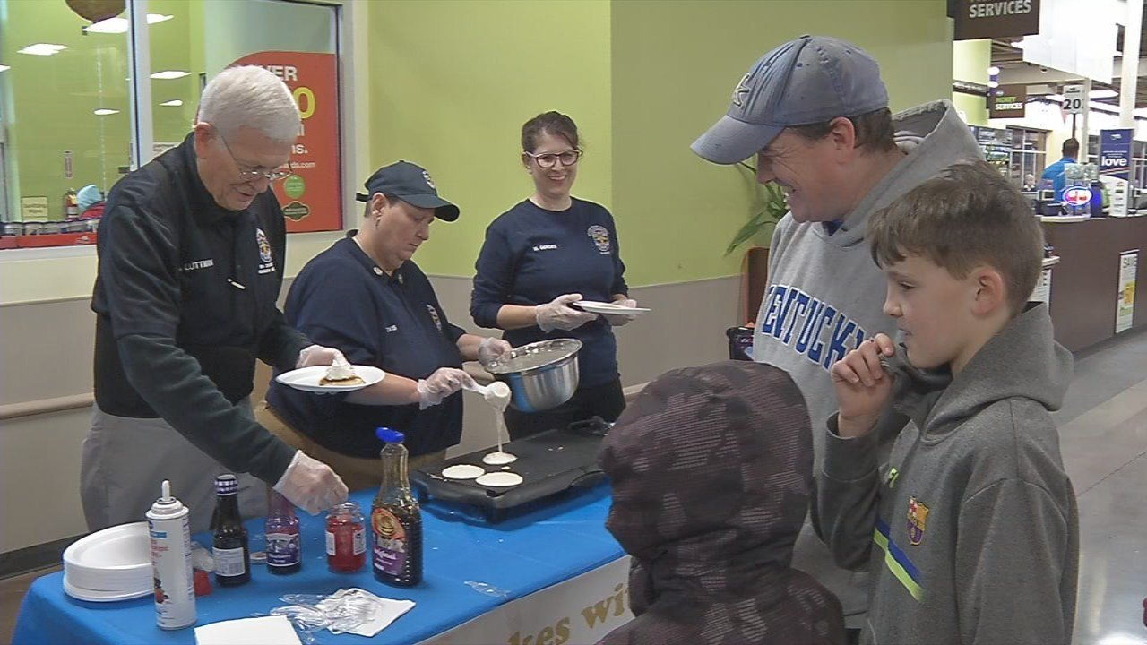 Members of LMPD served up pancakes for shoppers Saturday morning at the Holiday Manor Kroger.
