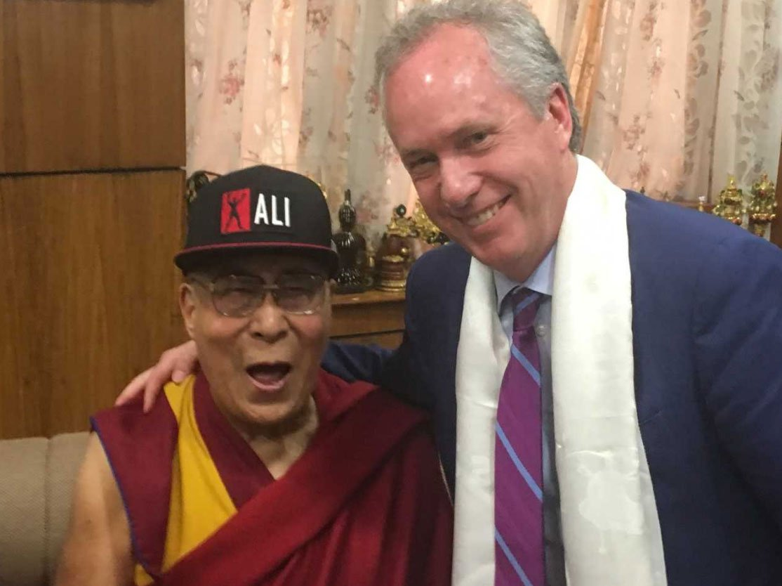 Louisville Mayor Greg Fischer met with the Dalai Lama earlier this week, posing for a photograph as the spiritual leader sported a ballcap celebrating a Louisville icon. (Image courtesy: Office of Louisville Mayor Greg Fischer / Twitter)