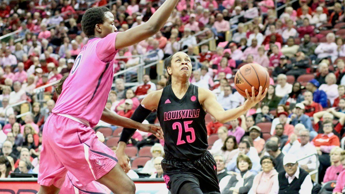 Asia Durr drives for two of her game-high 13 points against Virginia. (WDRB photo by Eric Crawford)