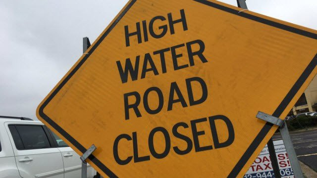 Authorities say drivers should never drive into standing water or drive around barricades.