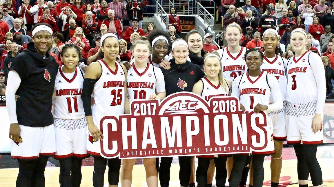 The Louisville women's basketball team celebrates its 2018 ACC regular season title. (WDRB photo by Eric Crawford)