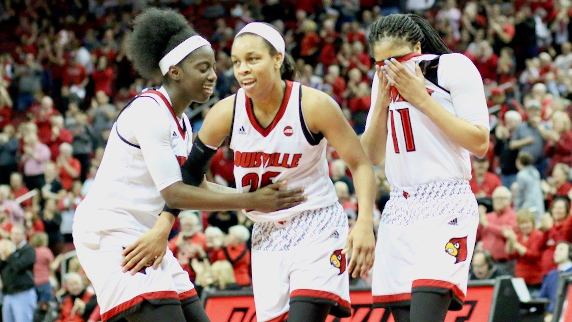 Asia Durr, with Jazmine Jones and Arica Carter, celebrates a buzz-beating three-pointer at the end of the third quarter. (WDRB photo by Eric Crawford)