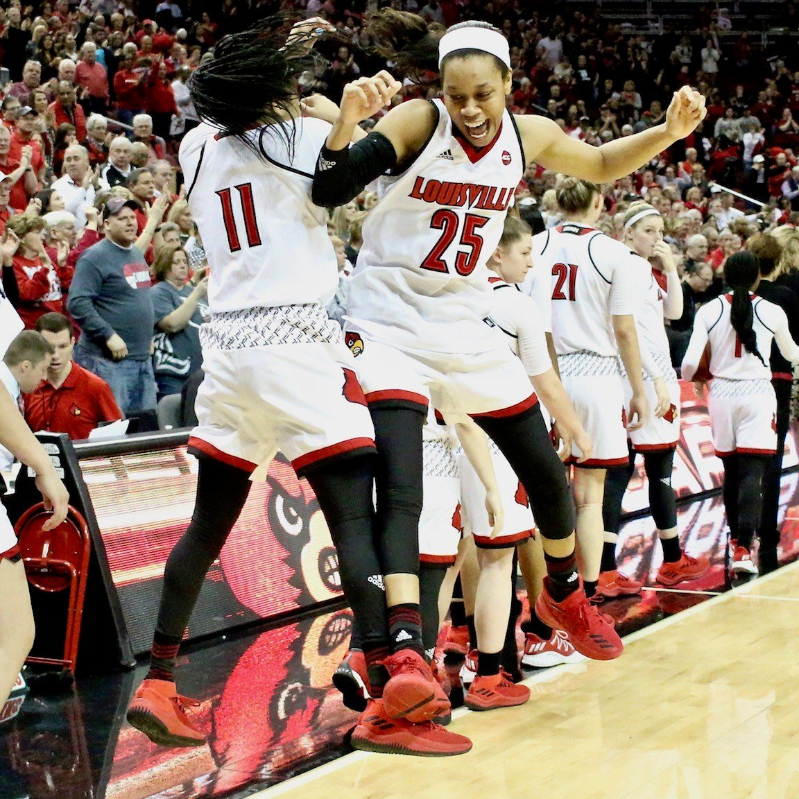 Asia Durr and Arica Carter celebrate the championship. (WDRB photo by Eric Crawford)