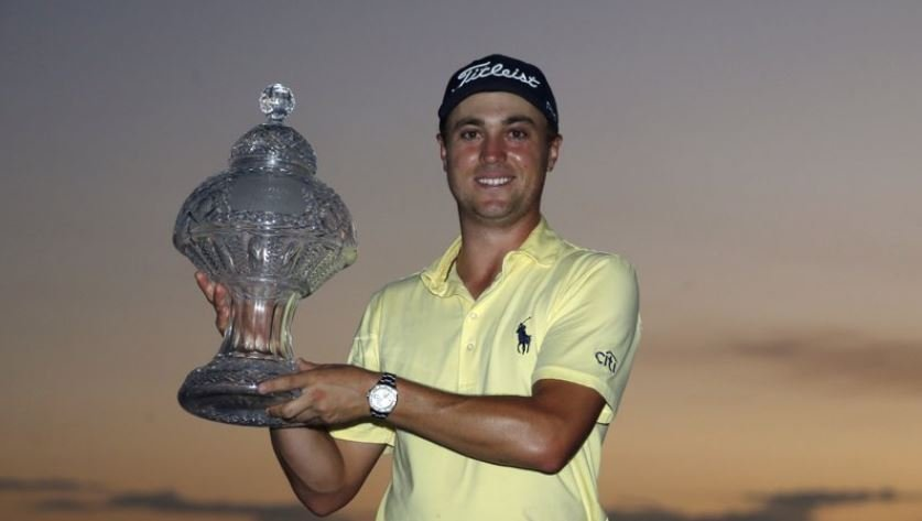 Justin Thomas nearly holed a wedge that got him into a playoff, and then hit 5-wood over the water and onto the green to beat Luke List in a sudden-death playoff Sunday in the Honda Classic. (AP Photo)