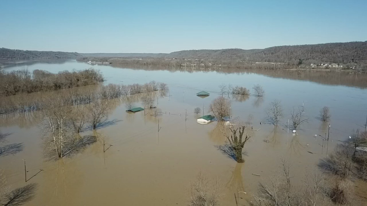 Carrollton, Kentucky. About 60 miles north of Louisville, the spilling Kentucky River formed a muddy brown lake around Ohio Valley Asphalt.