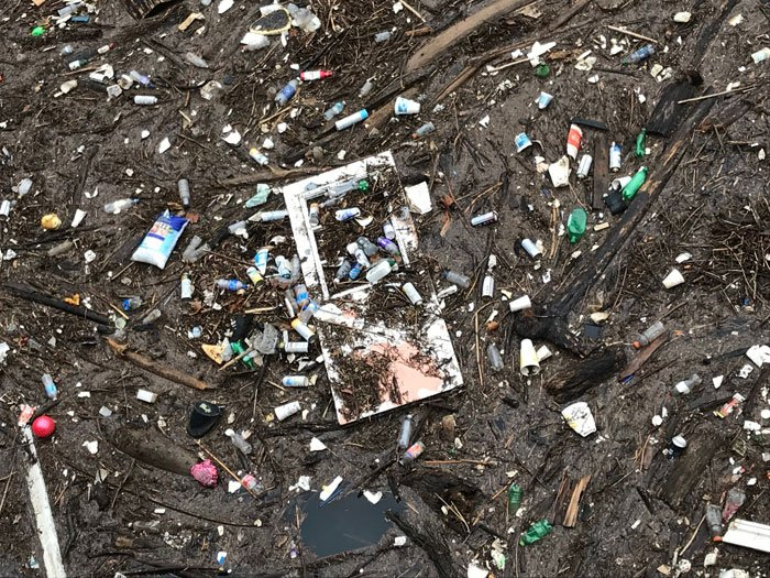 """Located at the Beargrass Flood Pump Station, """"Trash Island"""" is the name given to trash and debris -- including small things, like water bottles, and larger items, like coolers and car tires --that has accumulated there during the recent flooding."""
