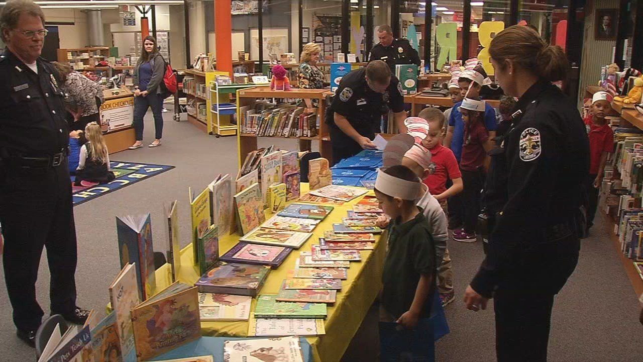 Officers shared the gift of reading to kids, collecting more than 1,500 new books so every student could take one home.