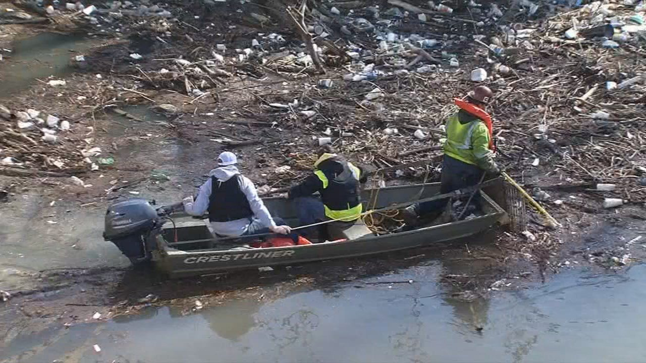 """Crews began the process of clearing away the so-called """"Trash Island"""" on Friday."""