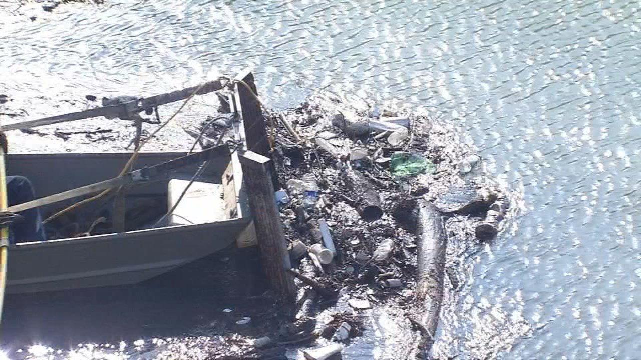 On Friday morning, a boat began pushing all the trash upstream to the Brownsboro Road overpass.